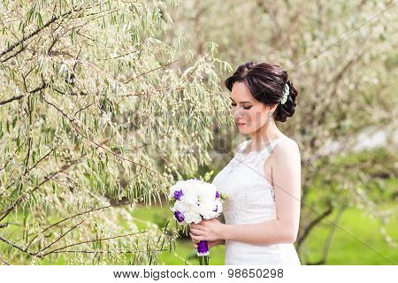 Beautiful bride in wedding dress and bridal bouquet