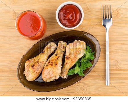 Fried Chicken Legs In Black Dish, Tomato Juice And Sauce