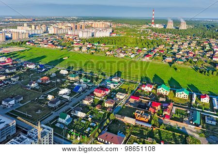 Residential area over city plant background.Tyumen