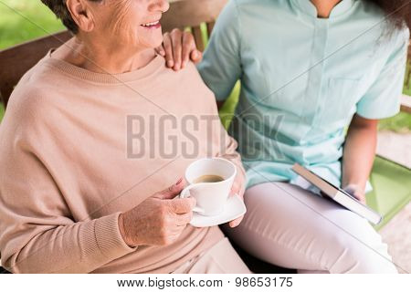 Caregiver Caring About Female Pensioner