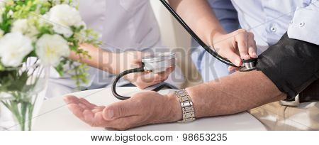 Nurse Using A Sphygmomanometer