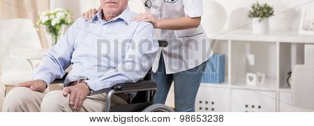Retiree Sitting In A Wheelchair