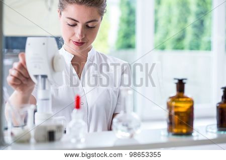 Lab Technician Doing Chemistry Experiment