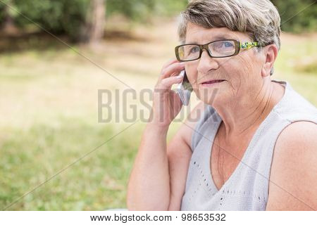 Elderly Female Talking On Mobilephone