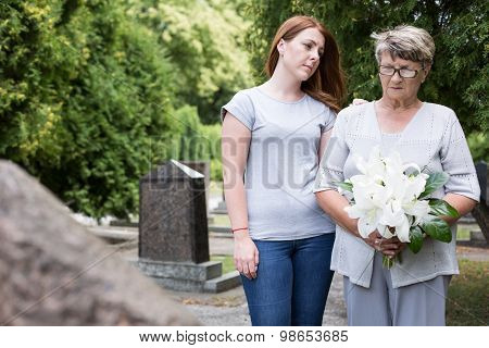 Woman Visiting Grave Of Husband