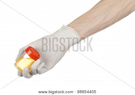 Medical Theme: Doctor's Hand In White Gloves Holding A Transparent Container With The Analysis Of Ur