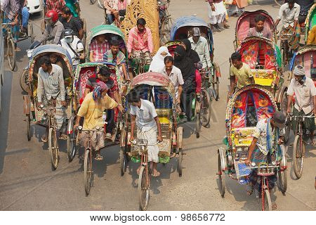 Rickshaws transport passengers in Dhaka, Bangladesh.
