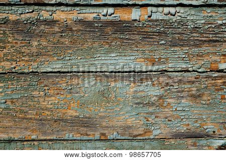 Surface Of An Old Wooden Wall With Peeling Paint
