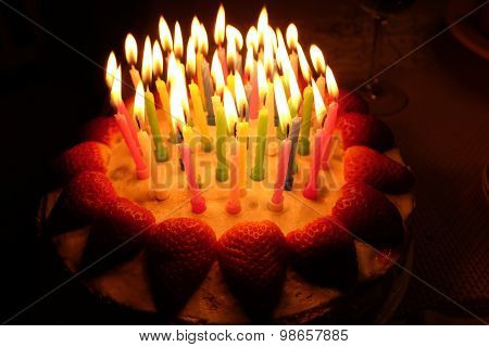 Birthday Strawberry Cake With Lighted Candles