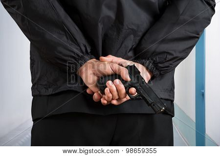 Close-up Of Bodyguard Holding Pistol