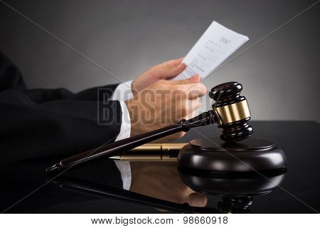 Judge Holding Document At Desk
