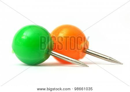 Two round color push pins on white background