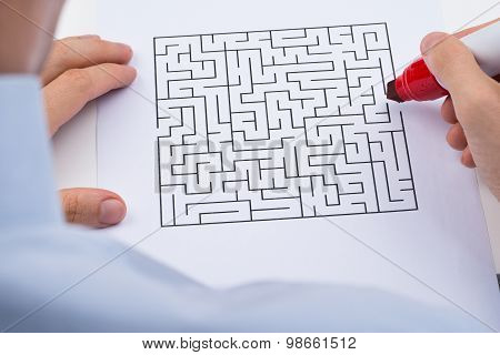 Person With Maze On Paper