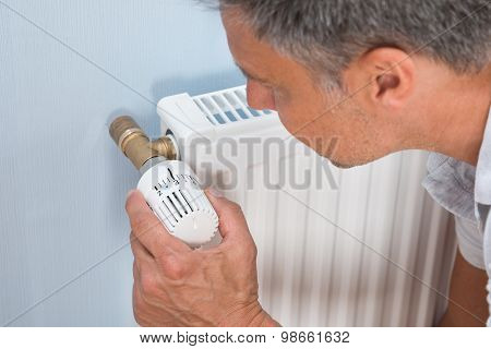 Close-up Of A Man Using Radiator