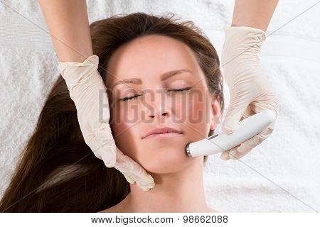 Woman Receiving Microdermabrasion Therapy