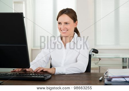Handicapped Businesswoman Working On Computer