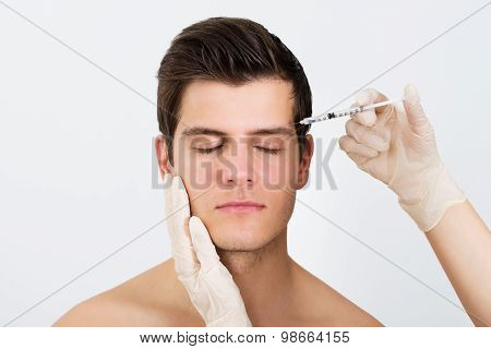 Person Hands Injecting Syringe With Botox