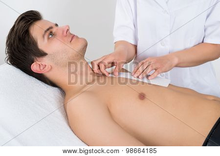 Beauty Therapist Waxing Man's Chest