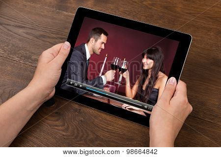Person Hands With Digital Tablet Showing Video