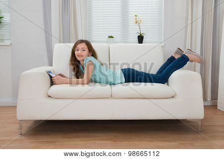 Girl With Digital Tablet In Living Room
