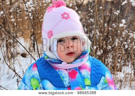 Small Child Against Winter Snow Landscape