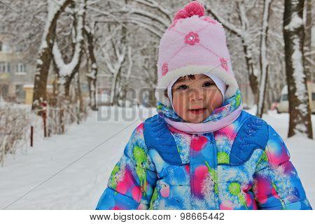 Small Child Against Winter Snow Landscape