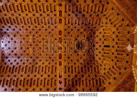 Caption of spectacular wooden roof inside San Diego church with extremely detailed decorated carving