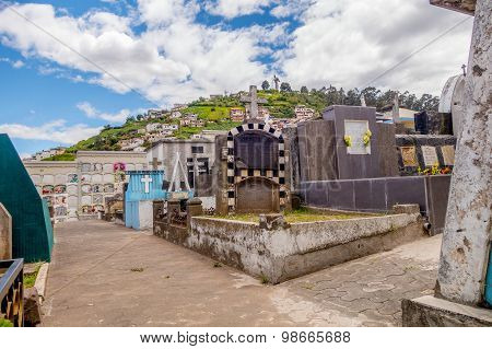 cemetary of San Diego church Quito shot from lower angle showing famous Panecillo mountain in backgr