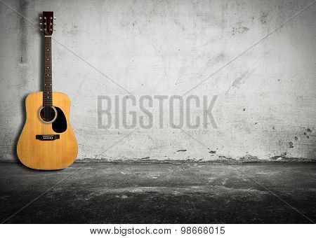 Acoustic Guitar Against Old Wall