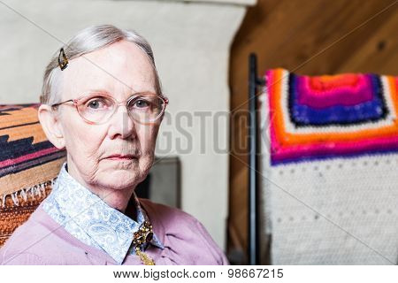 Elderly Woman In Livingroom