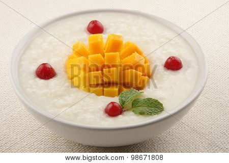 Bowl of healthy mango,cream rice pudding