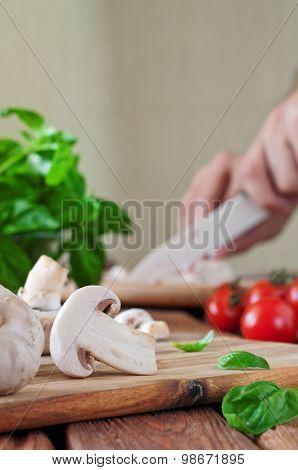 Food ingredients for pizza or pasta dishes on the cutting board