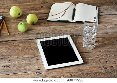 blank white tablet computer on wooden table closeup