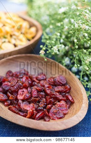 Cranberries In Wood Bowl With Blossom Background