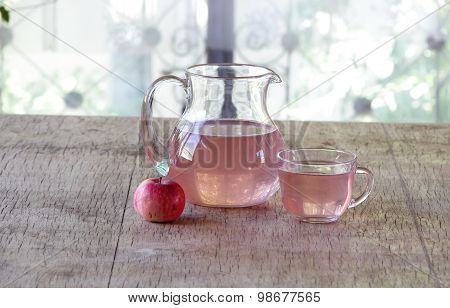 Still-life With An Apple And Compote In A Transparent Jug