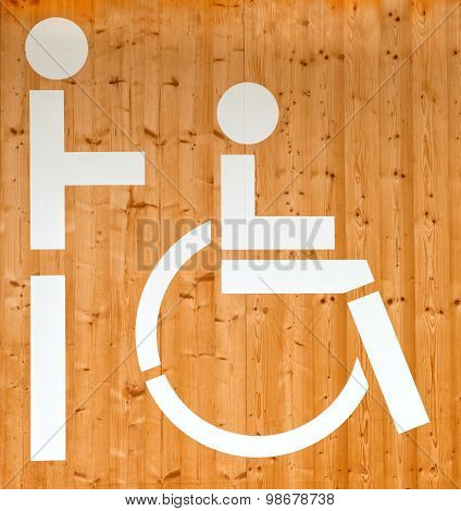 Disabled Sign On A Wooden Wall