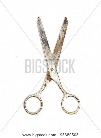 Old scissors isolated on a white background.