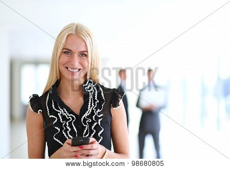 Business woman sending text message from her mobile