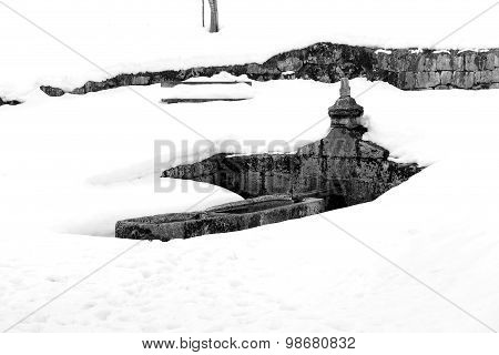 Big Stone Fountain With Freezing Cold Water In Winter
