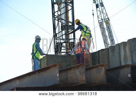 Construction workers stacking the maintain load test block at the construction site