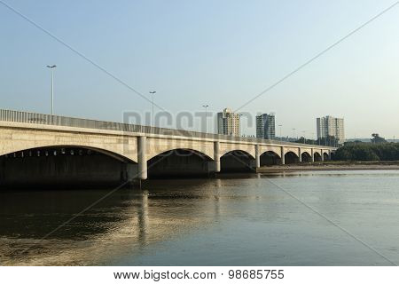 Bridge Over Umgeni River With Apartment Buildings In Background