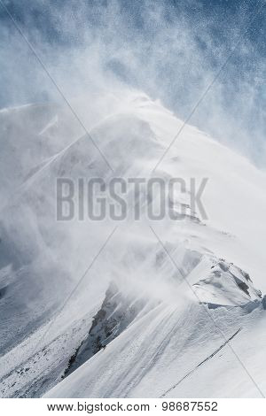 Wind Blowing the Snow From a Mountain Ridge