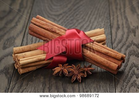cinnamon sticks and anise tied with ribbon