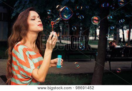 Beautiful Woman Blowing Bubbles