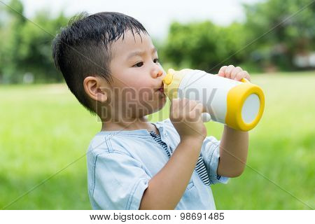 Little kid drink of water bottle