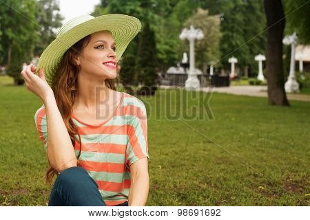 Attractive Young Woman In Park
