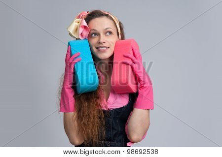 Young Housewife With Cleaning Sponge