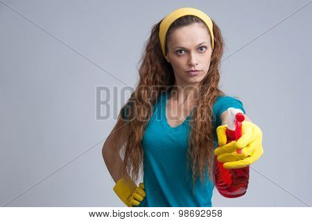 Woman Spraying With A Cleaning Fluid