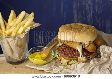 Hamburger, French Fries In A Paper Wrapper , Blue Background