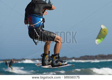 Kitesurfer jumping on a beautiful background